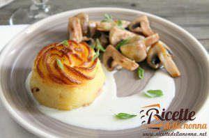 Tortino di patate e prosciutto di praga con fonduta di parmigiano