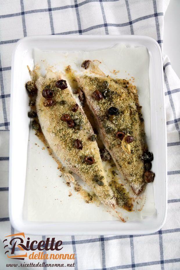 Foto filetti di pangasio con olive e capperi