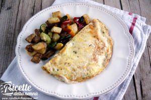 Omelette gustosa con mozzarella e origano