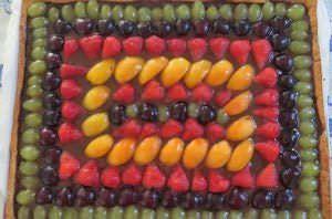 Crostata all'olio extravergine, cioccolato e frutta
