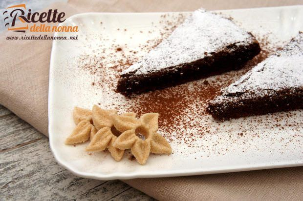 Torta noci, cioccolato e arancia ricetta e foto