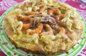 Torta di patate, melanzane, calamari e gamberi