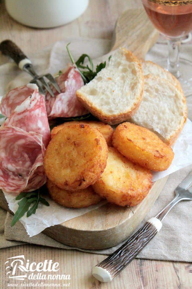 Foto frittelle di patate e cipolle